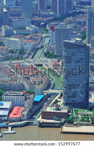Shanghai city aerial view with urban architecture over river in the day.