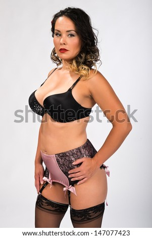 Shapely Young Brunette With Tattoos