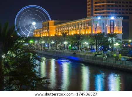 SHARJAH, UAE - OCTOBER 29: Ferris wheel in Al Qasba. Sharjah - third largest and most populous city in United Arab Emirates, on October 29, 2013.