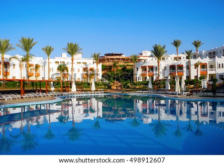 Sharm El Sheikh, Egypt - August 25, 2016: Swimming pool and palm trees at the resort in Sharm El Sheikh.
