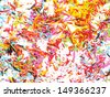 Sharpened pencils shavings background. A multicolored detail. - stock photo