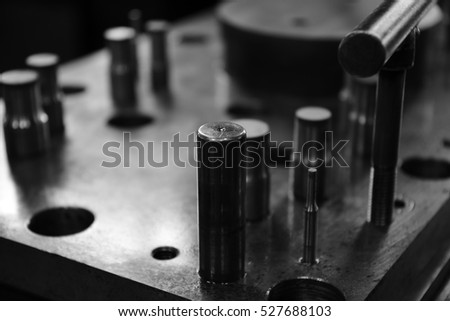 Sheet Metal Stamping Tool Die. Progressive Stamping System. Black and White Photography.