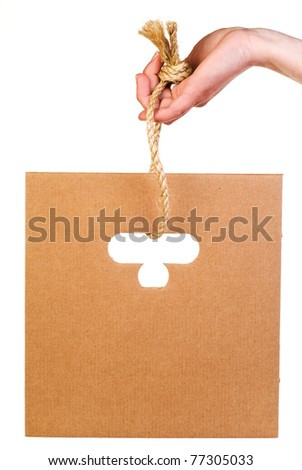 Sheet of corrugated cardboard hanging on rope isolated on white