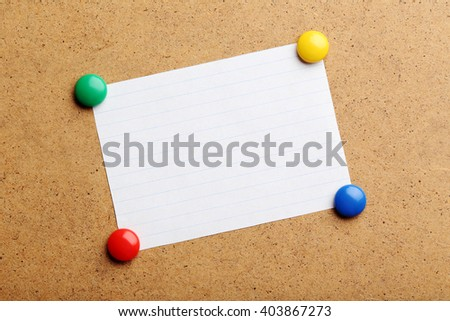 Sheet of paper on brown wooden background