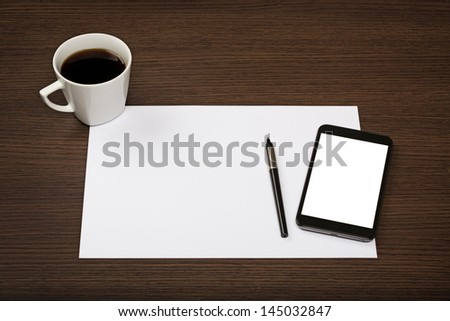 Sheet of paper, smartphone with blank screen, pen and cup of coffee on dark wooden office desk.