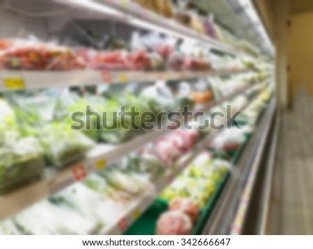 Shelf with fruits in supermarket blurred background