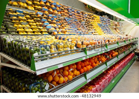 Shelf with fruits, TM's removed, price tags left in place and contain no copyright.