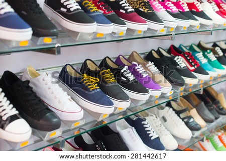 Shelves with casual shoes at  shop