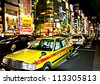 SHINJUKU, TOKYO - NOVEMBER 23:  The neon lights of Shinjuku are a major attraction in Tokyo on November 23, 2008 in Tokyo, Japan - stock photo