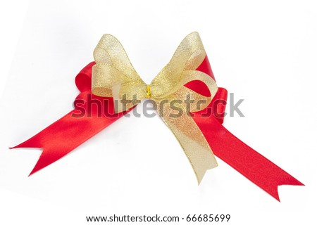 Shiny red and gold ribbon bow on white background