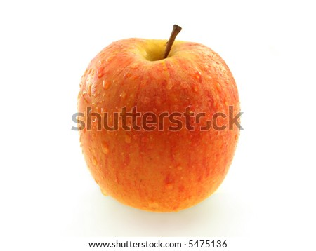 Shiny red apple with water on white background