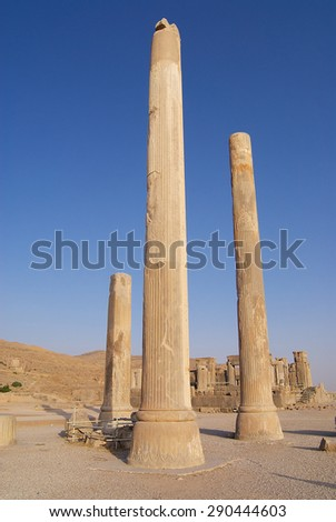 SHIRAZ, IRAN - JUNE 19, 2007: Exterior of the ancient columns at the ruins of Persepolis in Shiraz, Iran. Persepolis is a UNESCO World Heritage site.