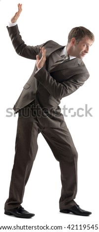 Shocked businessman protecting himself with hands on white background