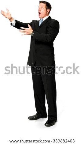 Shocked Caucasian man with short medium blond hair in business formal outfit pointing using palm - Isolated