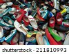 Shoes for sale at street market. Pile of assorted footwear abstract background. - stock photo