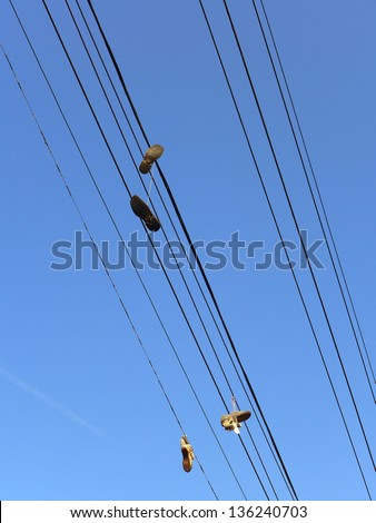 Shoes hanging from power lines are said to be gang symbols or the