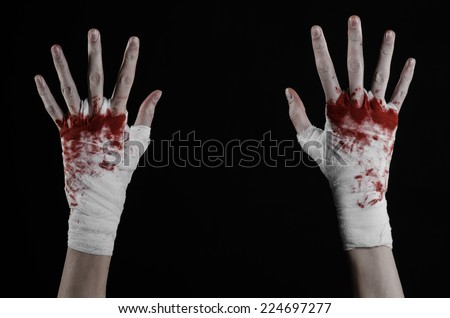shook his bloody hand in a bandage, fight club, street fight, violence, black background, isolated, boxer