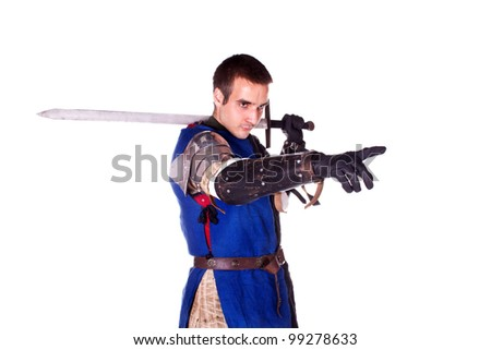 Shooting in a studio in the armor, and people with weapons.