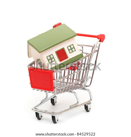 shopping cart trolley with house isolated on white