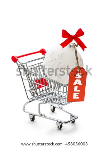 Shopping cart with big Christmas ball, isolated