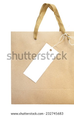 Shopping paper bag and white empty price tag on white background