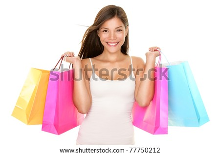 Shopping woman happy smiling holding shopping bags isolated on white background. Lovely fresh young mixed race Asian Caucasian female model.