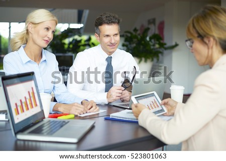 Shot of a business team working on new financial investment. Businesswoman presenting new concepts to her colleagues.