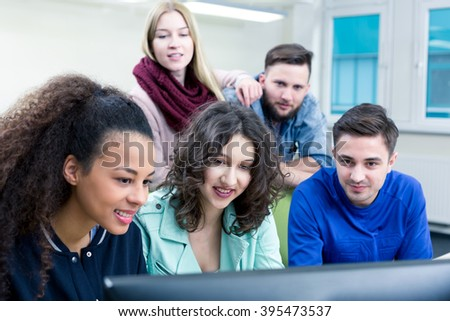 Shot of a group of students working together during the IT class