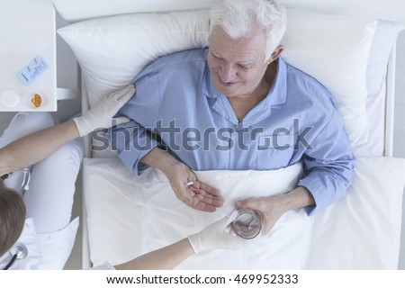 Patient Lady On Sick Bed : ... the glass of water to the elder senior patient lying on a hospital bed