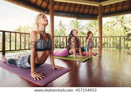 group young women sitting on floor stock photo 464516003