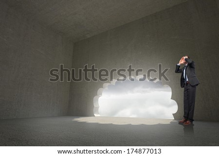 Shouting businessman against cloud door in dark room