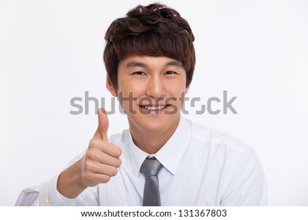 showing thumb Asian young business man close up shot  isolated on white background.