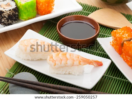 Shrimp sushi on wooden table
