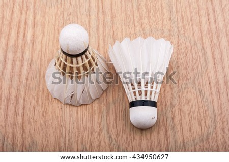 Shuttlecock on nature wooden board.