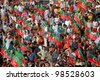 SIALKOT, PAKISTAN - MAR 23: Over hundred thousand people gather at Jinnah Cricket Stadium during a political rally of cricketer turned politician Imran Khan on March 23, 2012 in Sialkot, Pakistan - stock photo