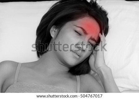 sick woman sleep with fever and headache on bed