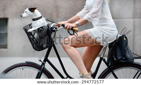 Side shot of woman and dog on bike