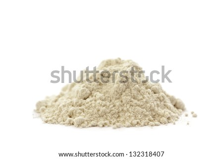 Side view of a pile of organic wheat flour on white background.