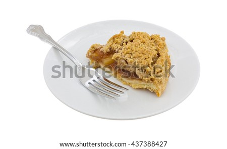 Side view of a slice of Dutch apple pie on a plate with a fork isolated on a white background.