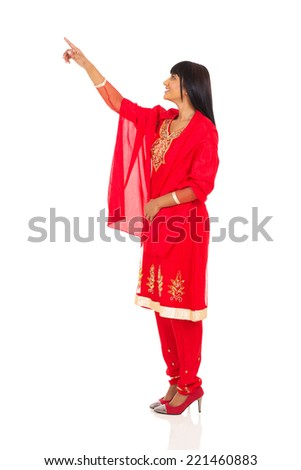 side view of indian woman pointing empty space