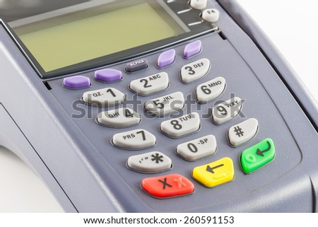 Side view of old credit card reader machine on white background