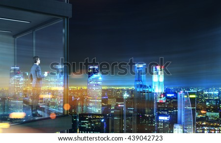 Side view of young businessman with coffee cup in hand standing on panoramic balcony with Singapore city view at night. 3D Rendering
