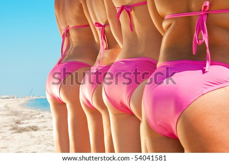 side view of young girls bottom in pink bikini