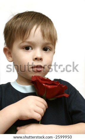 Sight of the boy with a flower in a hand