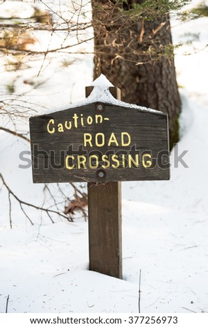 Sign Caution Road Crossing in winter