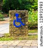 Sign for  elderly made from brick  in garden - stock photo