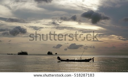 sihouettes photo of seascape with fishery boat in the ocean in morning time - soft and select focus