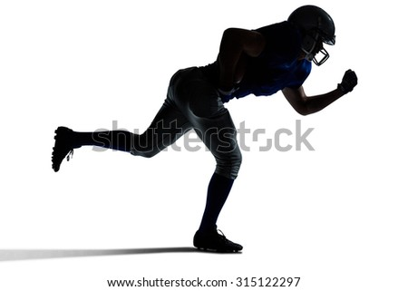 Silhouette American football player running against white background