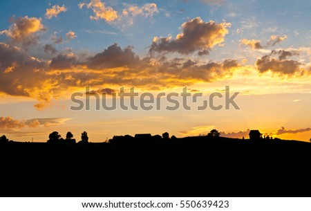 Silhouette at sunset sky background.