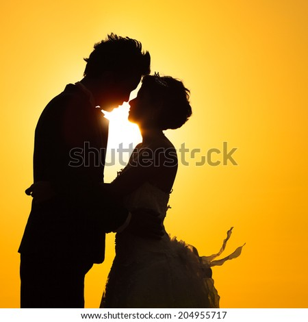 Silhouette couple love with sunset